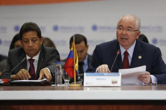 Venezuela's Foreign Minister Ramirez speaks next to Venezuela's Oil and Mining Minister Chavez during the 14th Cabinet Meeting of Petrocaribe in Caracas